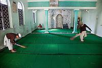 Madrasa Students Sweeping Mosque before Prayers, Madrasa Imdadul Uloom, Dehradun, India.