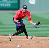 Second baseman Mookie Betts (7) of the Greenville Drive takes infield practice during the team's first workout on Media Day just prior to the start of the 2013 season on Tuesday, April 2, 2013, at Fluor Field at the West End in Greenville, South Carolina. Betts was a 5th Round pick by the Boston Red Sox in the 2011 First-Year player Draft. (Tom Priddy/Four Seam Images)