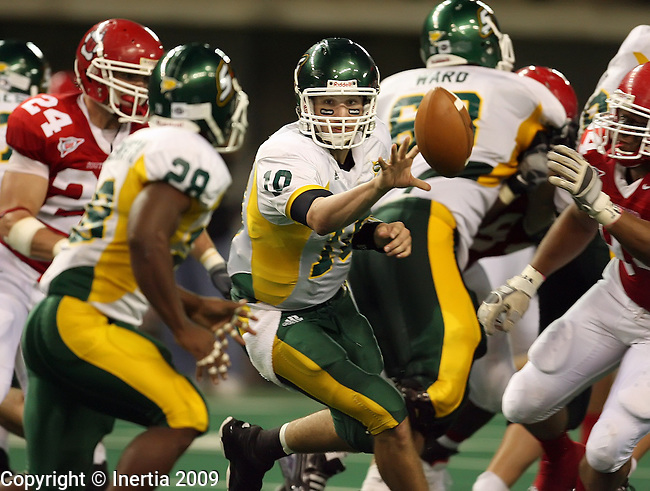 VERMILLION, SD - SEPTEMBER 26: Quarterback Brian Babin #10 of Southeastern Louisiana pitches  the ball on an option lay to Jasper Ducksworth #28 during the third quarter of their game against the University of South  Dakota Saturday evening at the DakotaDome in Vermillion. (Photo by Dave Eggen/Inertia)