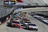 BRISTOL, TENNESSEE - MAY 31: Denny Hamlin, driver of the #11 FedEx Express Toyota, and Kyle Busch, driver of the #18 Skittles Toyota, lead the field during the NASCAR Cup Series Food City presents the Supermarket Heroes 500 at Bristol Motor Speedway on May 31, 2020 in Bristol, Tennessee. (Photo by Jared C. Tilton/Getty Images)