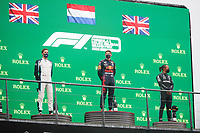 29th August 2021; Spa Francorchamps, Stavelot, Belgium: FIA F1 Grand Prix of Belgium,  race day: podium VERSTAPPEN Max (ned), Red Bull Racing Honda RB16B, RUSSELL George (gbr), Williams Racing F1 FW43B, HAMILTON Lewis (gbr), Mercedes AMG F1 GP W12 E Performance on the podium after the formation laps in heavy rain before cancellation of the race due to standing water