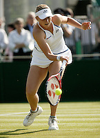 28-6-06,England, London, Wimbledon, first round match,  Michaella Krajicek