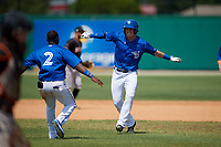 Dunedin Blue Jays Kacy Clemens (21) celebrates with Chavez Young (2) after hitting a game winning single to score Ryan Noda (not shown) during a Florida State League game against the Jupiter Hammerheads on May 16, 2019 at Jack Russell Memorial Stadium in Clearwater, Florida.  Dunedin defeated Jupiter 1-0.  (Mike Janes/Four Seam Images)