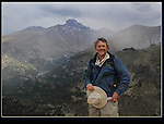 John descending Flattop Mountain with Longs Peak behind.<br /> John moved to Colorado to attend Colorado State University and graduated with a BS in zoology. He leads Rocky Mountain National Park photo tours and a variety of photo workshops.
