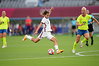 TOKYO, JAPAN - JULY 20: Tobin Heath #7 of the United States takes a shot during a game between Sweden and USWNT at Tokyo Stadium on July 20, 2021 in Tokyo, Japan.
