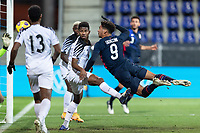 WIENER NEUSTADT, AUSTRIA - : Nicholas Gioacchini #9 of the United States with a diving header during a game between  at Stadion Wiener Neustadt on ,  in Wiener Neustadt, Austria.
