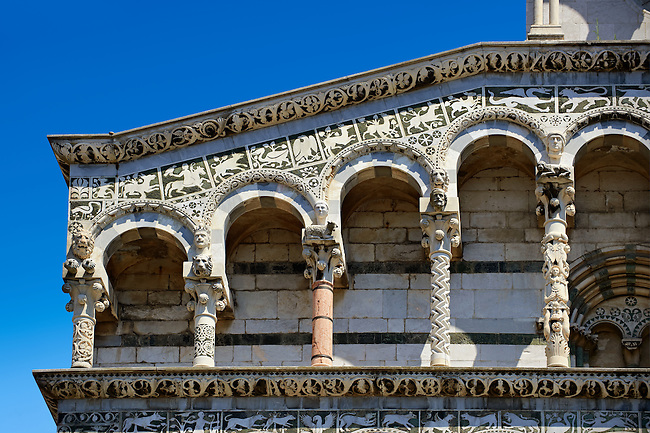 Close up of the Arcades and corner of St Michele of the 13th century Romanesque facade of the San Michele in Foro,  a Roman Catholic basilica church in Lucca, Tunscany, Italy
