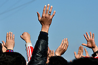 Pictured: Migrant men raise his hands in the air in protest to the border being shut Tuesday 01 March 2016<br /> Re: Thousands of migrants, still stranded at the Greek FYRO Macedonian border in Idomeni, Greece