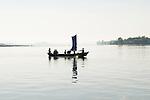 Family crossing the Lemro river. Myanmar (Burma) 2008.