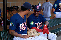 Elizabethton Twins designated hitter Yunior Severino (22) talks with Jared Akins (12) before a game against the Bristol Pirates on July 28, 2018 at Joe O'Brien Field in Elizabethton, Tennessee.  Elizabethton defeated Bristol 5-0.  (Mike Janes/Four Seam Images)