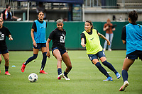TACOMA, WA - JULY 31: Dzsenifer Marozsan #8 of the OL Reign passes the ball before a game between Racing Louisville FC and OL Reign at Cheney Stadium on July 31, 2021 in Tacoma, Washington.