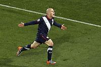 Michael Bradley (R) of USA celebrates scoring the equalising goal to make the score 2-2 against Slovenia