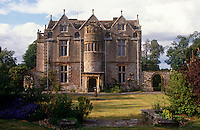 The garden facade of a Jacobean country house reveals its lead-paned windows