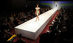 A model walks the runway wearing Cesar Galindo on the first day of the Fashion Houston 2010 presented by Audi at the Wortham Theater Monday Oct. 11, 2010. (Dave Rossman/For the Chronicle)