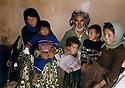 Iran 1982 .In the village of Ghalve, a Kurdish family who lost three children in a bombing  .Iran 1982 .Au village de Ghalve, une famille kurde ayant perdu 3 enfants au cours d'un bombardement .