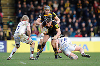 Tom Lindsay of London Wasps is tackled by David Seymour (left) and Marc Jones of Sale Sharks during the Aviva Premiership match between London Wasps and Sale Sharks at Adams Park on Saturday 1st March 2014 (Photo by Rob Munro)