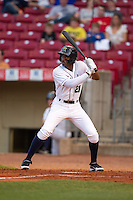 Cedar Rapids Kernels shortstop Niko Goodrum #21 bats during a game against the Lansing Lugnuts at Veterans Memorial Stadium on April 29, 2013 in Cedar Rapids, Iowa. (Brace Hemmelgarn/Four Seam Images)