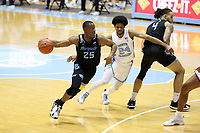 CHAPEL HILL, NC - FEBRUARY 24: Koby McEwen #25 of Marquette drives against Kerwin Walton #24 of North Carolina during a game between Marquette and North Carolina at Dean E. Smith Center on February 24, 2021 in Chapel Hill, North Carolina.