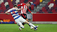 Rob Dickie of QPR tackles Brentford's Marcus Forss during Brentford vs Queens Park Rangers, Sky Bet EFL Championship Football at the Brentford Community Stadium on 27th November 2020