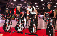 Sarah Walker, races bikers in a WattBike power challenge with from left, Eileen Hauraki, 15, Suzy Clarkson (Coca Cola Corporate Affairs Manager) and Charley-Casey Jackson, 13, (both girls from Tokoroa), at the launch of the Move60 app at Mystery Creek Events Centre, Hamilton, New Zealand, Saturday 29 March 2014. Photo: Stephen Barker/Barker Photography. ©Coca Cola South Pacific