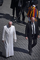 Pope Francis Domenico Giani personal bodyguard the Pope.during of a weekly general audience at St Peter's square in Vatican. April 19, 2017