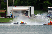 Frame 7: Grant Hearn (12-H) goes for a tumble at the start of the final heat 1.  (runabout)