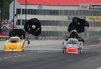 May 13, 2011; Commerce, GA, USA: NHRA funny car driver Matt Hagan (right) and Jeff Arend during qualifying for the Southern Nationals at Atlanta Dragway. Mandatory Credit: Mark J. Rebilas-
