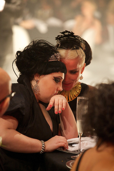 Beth Ditto and Daphne Guinness whisper during the speeches at Elton John's White Tie and Tiara Ball