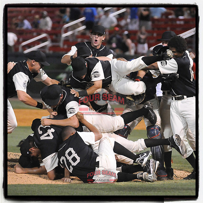 #OTD On This Day, June 20, 2009, Greenville Drive players celebrated winning the first half Southern Division title for the South Atlantic League with a 15-3 win over the Lexington Legends at Fluor Field at the West End in Greenville, S.C. Drive players were wearing Greenville Mill League throwback jerseys that were being auctioned off after the game. (Tom Priddy/Four Seam Images) #MiLB #OnThisDay #MissingBaseball #nobaseball #stayathome #minorleagues #minorleaguebaseball #Baseball #SallyLeague #AloneTogether