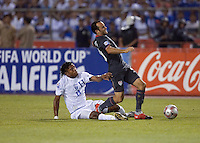 Carlo Costly tackles Landon Donovan from behind as the.USA clinches a spot in the  2010 World Cup after defeating Honduras in 3-1 during CONCACAF qualifying in San Pedro Sula, Honduras, October 10, 2009.