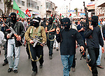 Palestinian gunmen march in front of the funeral procession of 15year-old Saber Edrees in the West Bank town of Ramallah Wednesday Nov. 15, 2000. Barsh was killed during clashes with Israeli troops on Tuesday. Photo by Quique Kierszenbaum