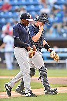 Charleston RiverDogs starting pitcher Roansy Contreras (7) and catcher Josh Breaux (34) during a game against the Asheville Tourists at McCormick Field on April 10, 2019 in Asheville, North Carolina. The  RiverDogs defeated the Tourists 5-3. (Tony Farlow/Four Seam Images)
