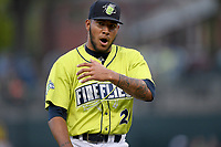 Eighteen-year-old Mets prospect, Simeon Woods-Richardson (21) of the Columbia Fireflies, shouts after completing five innings of work to pick up the 5-2 win in a game against the Augusta GreenJackets on Thursday, July 11, 2019 at Segra Park in Columbia, South Carolina. (Tom Priddy/Four Seam Images)