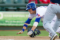 Round Rock Express outfielder Jim Adduci (24) prepares to slide into home plate against the Oklahoma City RedHawks during the Pacific Coast League baseball game on August 25, 2013 at the Dell Diamond in Round Rock, Texas. Round Rock defeated Oklahoma City 9-2. (Andrew Woolley/Four Seam Images)