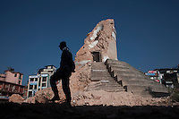 A Nepali policeman stands guard in front of the destroyed Dharahara tower at Kathmandu, Nepal. May 03, 2015