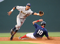Shortstop Kelvin Castro (29) of the Charleston RiverDogs can't reach a throw from catcher J.R. Murphy as Shannon Wilkerson (10) of the Greenville Drive steals second base in a game on Aug. 24, 2010, at Fluor Field at the West End in Greenville, S.C. Photo by: Tom Priddy/Four Seam Images