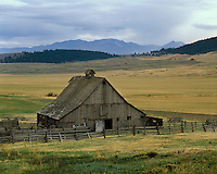 Old barn and fence on a ranch near Baker below the Blue Mountains; Union County, OR