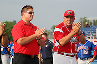Batavia Muckdogs trainer Mike Petraca and hitting coach Roger LaFrancois #19 during a game against the Auburn Doubledays at Dwyer Stadium on June 18, 2012 in Batavia, New York.  Auburn defeated Batavia 6-5.  (Mike Janes/Four Seam Images)