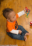 5 month old baby boy shaking plastic connecting links chain