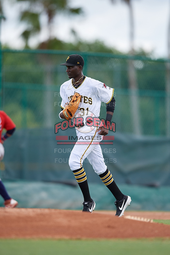 GCL Pirates left fielder Juan Pie (31) jogs to the dugout during a Gulf Coast League game against the GCL Twins on August 6, 2019 at Pirate City in Bradenton, Florida.  GCL Twins defeated the GCL Pirates 1-0 in the second game of a doubleheader.  (Mike Janes/Four Seam Images)