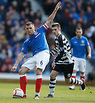 Lee McCulloch fires the ball for forwards from midfield
