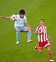 MELBOURNE, AUSTRALIA - NOVEMBER 27: Sung Hwan Byun of Sydney FC gets the ball ahead of Adrian Zahra of the Heart during the round 16 A-League match between the Melbourne Heart and Sydney FC at AAMI Park on November 27, 2010 in Melbourne, Australia. (Photo by Sydney Low / Asterisk Images)