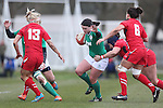 Wales centre Gemma Rowland tackles her opposite number Jackie Shiels.<br /> 6 Nations Championship<br /> Wales v Ireland Women<br /> St Helens Swansea<br /> 15.03.15<br /> ©Steve Pope - SPORTINGWALES