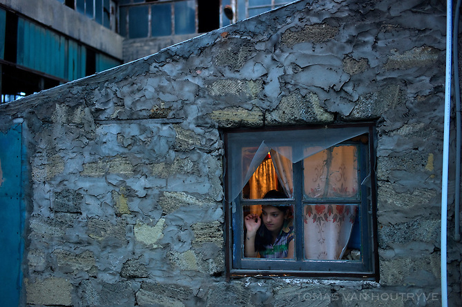 A refugee from the Nagorno-Karabakh conflict live in part of the abandoned DSK Cement factory in the outskirts of Baku, Azerbaijan. Despite a massive surge of newly constructed apartments in Baku, many of the least well off residents continue to live in poor housing. Most of the new housing developments are focused on the rich.