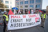 """Migrantische Bauarbeiter, welche beim Bau des neuen Luxus-Einkaufszentrum """"Mall of Berlin"""" unweit des Potdsamer Platz beschaeftigt waren, protestieren vor dem Eingang des Einkaufzentrum. Sie haben siet Monaten keinen Lohn fuer ihre Arbeit bekommen. Schriftliche Arbeitsvertraege waren ihnen verweigert worden und die Arbeitgeber """"Metatec-Fundus GmbH"""" aus Berlin und """"openmallmasters GmbH"""" aus Frankfurt/M. haben sie in Unterkuenften mit bis zu 16 Personen in 2-Zimmerwohnungen untergebracht. Dem Bauherren des Luxus-Einkaufszentrum """"Fettchenauer Controlling & Logistic GmbH"""" waren diese Zustaende angeblich bekannt und er soll sie stillschweigend geduldet haben, so die Arbeiter.<br /> 27.11.2014, Berlin<br /> Copyright: Christian-Ditsch.de<br /> [Inhaltsveraendernde Manipulation des Fotos nur nach ausdruecklicher Genehmigung des Fotografen. Vereinbarungen ueber Abtretung von Persoenlichkeitsrechten/Model Release der abgebildeten Person/Personen liegen nicht vor. NO MODEL RELEASE! Nur fuer Redaktionelle Zwecke. Don't publish without copyright Christian-Ditsch.de, Veroeffentlichung nur mit Fotografennennung, sowie gegen Honorar, MwSt. und Beleg. Konto: I N G - D i B a, IBAN DE58500105175400192269, BIC INGDDEFFXXX, Kontakt: post@christian-ditsch.de<br /> Bei der Bearbeitung der Dateiinformationen darf die Urheberkennzeichnung in den EXIF- und  IPTC-Daten nicht entfernt werden, diese sind in digitalen Medien nach §95c UrhG rechtlich geschuetzt. Der Urhebervermerk wird gemaess §13 UrhG verlangt.]"""
