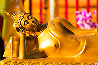 Famous Wat Phra That temple, golden reclining Buddha statue close-up in Doi Suthep mountains near Chiang Mai Thailand, Southeast Asia