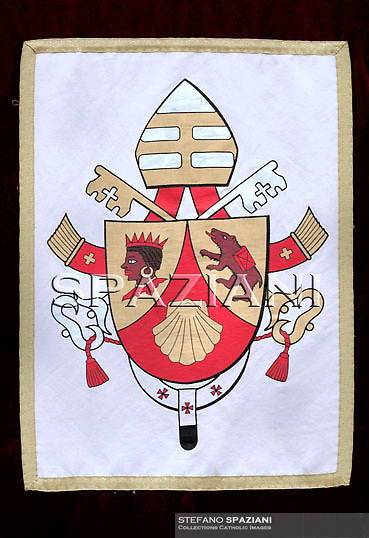 """The coat of arms of Pope Benedict XVI...The coat of arms of Pope Benedict XVI.The coat of arms of Pope Benedict XVI was designed by then Archbishop Andrea Cordero Lanza di Montezemolo (who later was created a Cardinal) soon after the papal election. Benedict's coat of arms has omitted the papal tiara, which traditionally appears in the background to designate the Pope's position as a worldly ruler like a king, replacing it with a simple mitre, emphasising his spiritual authority.[142] . .Escutcheon Gules, chape in or, with the....more ».The coat of arms of Pope Benedict XVI.The coat of arms of Pope Benedict XVI was designed by then Archbishop Andrea Cordero Lanza di Montezemolo (who later was created a Cardinal) soon after the papal election. Benedict's coat of arms has omitted the papal tiara, which traditionally appears in the background to designate the Pope's position as a worldly ruler like a king, replacing it with a simple mitre, emphasising his spiritual authority.[142] . .Escutcheon Gules, chape in or, with the scallop shell of the second; the dexter chape with a moor's head in natural colour, crowned and collared of the first, the sinister chape a bear trippant in natural colour, carrying a pack gules belted sable . .Symbolism Scallop shell: The symbolism of the scallop shell is multiple, one of the meanings is thought to represent Saint Augustine. While a doctoral candidate in 1953, Fr. Joseph Ratzinger wrote his dissertation on The People of God and the House of God in Augustine's Teaching is always about the Church, and therefore has a personal connection with the thought of this great Doctor of the Church..Moor of Freising: The Moor's head is an heraldic charge associated with Freising, Germany..Corbinian's bear: A legend states that while travelling to Rome, Saint Corbinian's pack horse was killed by a bear. He commanded the bear to carry the load. Once he arrived, he released it from his service, and it returned to Bavaria. The implication is that """"C"""