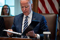 United States President Joe Biden looks over his notes during a cabinet meeting at the White House in Washington, D.C., U.S., on Tuesday, July 20, 2021. Biden administration officials say they're starting to see signs of relief for the global semiconductor supply shortage, including commitments from manufacturers to make more automotive-grade chips for car companies. <br /> CAP/MPI/RS<br /> ©RS/MPI/Capital Pictures
