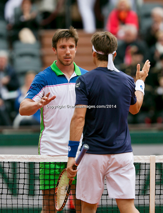 France, Paris, 27.05.2014. Tennis, French Open, Roland Garros, Igor Sijsling (NED) congratulates David Ferrer (ESP) with his victory<br /> Photo:Tennisimages/Henk Koster