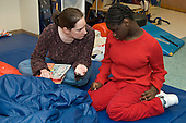 MR / Albany, NY.Langan School at Center for Disability Services .Ungraded private school which serves individuals with multiple disabilities.Speech language pathologist talks with a student. Student has very limited verbal skills. Girl: 10, African-American, cerebral palsy, expressive and receptive language delays.MR: And6; Dub1.© Ellen B. Senisi